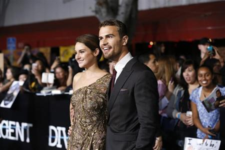 "Shailene Woodley and Theo James pose at the premiere of ""Divergent"" in Los Angeles"