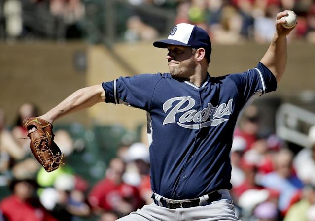 San Diego Padres starting pitcher Eric Stults throws against the Arizona Diamondbacks during the first inning of a spring training baseball game in Scottsdale, Ariz., Sunday, March 9, 2014. (AP Photo/Chris Carlson)