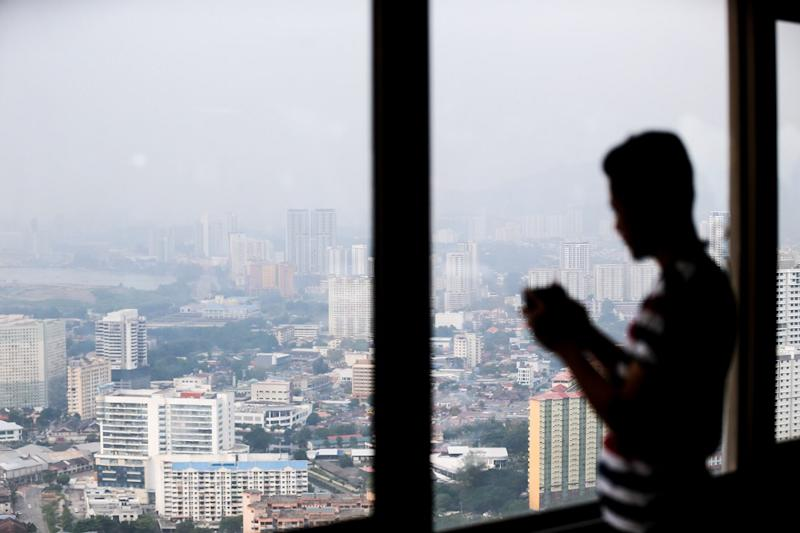 An aerial view of George Town on a hazy afternoon is seen from the Komtar building September 11, 2019. — Picture by Sayuti Zainudin