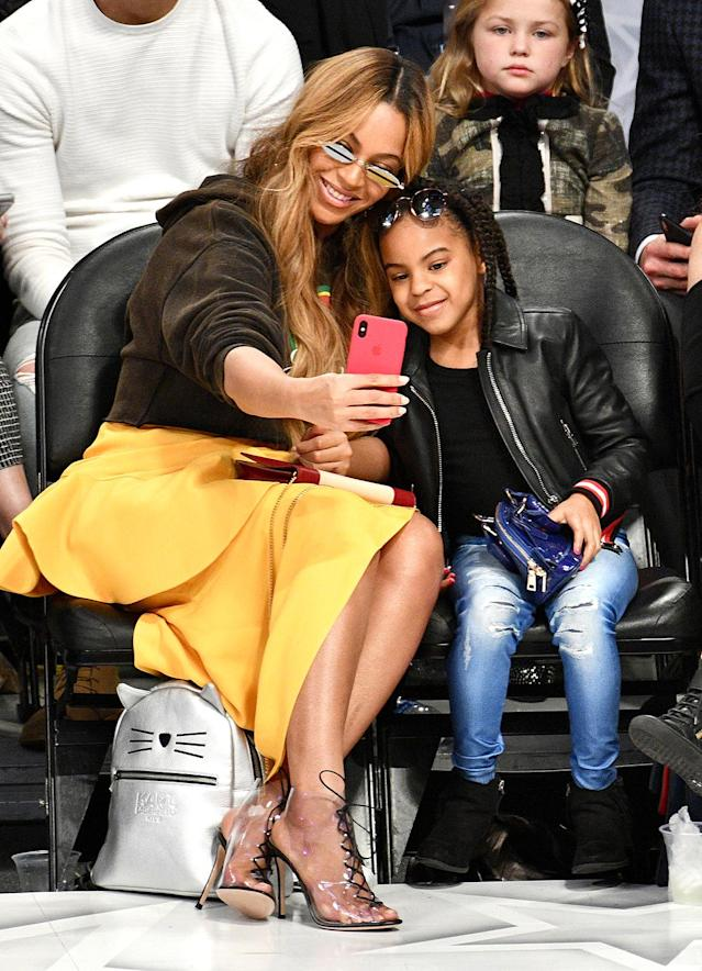 <p>Jay-Z's lovely ladies took a selfie as they sat courtside at the NBA All-Star Game, held at the Staples Center in Los Angeles on Sunday. (Photo: Allen Berezovsky/Getty Images) </p>