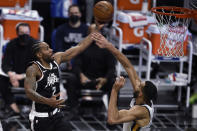 Los Angeles Clippers forward Kawhi Leonard, left, jumps up for a shot while Utah Jazz center Rudy Gobert defends during the first half of an NBA basketball game in Los Angeles, Friday, Feb. 19, 2021. (AP Photo/Kelvin Kuo)
