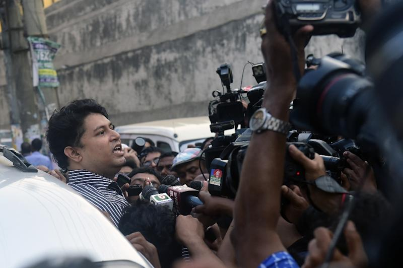 A relative of Jamaat-e-Islami leader Mohammad Kamaruzzaman talks to the media after meeting with him at the central prison in Dhaka on April 11, 2015 (AFP Photo/Munir Uz Zaman)