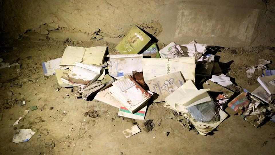 """Bloodstained books and notebooks of students are seen on the ground at the scene of a suicide attack that targeted an educational center """"Kohsar Danesh"""" in Kabul, Afghanistan, 24 October 2020."""
