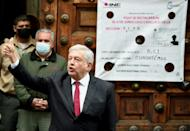 Mexican President Andres Manuel Lopez Obrador shows his thumb after voting in the capital