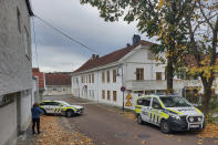 Police cordon off one of the sites where a man killed several people on Wednesday afternoon, in Kongsberg, Norway, Thursday, Oct. 14, 2021. The bow-and-arrow rampage by a man who killed five people in a small town near Norway's capital appeared to be a terrorist act, authorities said Thursday, a bizarre and shocking attack in a Scandinavian country where violent crime is rare. Police identified the attacker as Espen Andersen Braathen, a 37-year-old Danish citizen, who was arrested on the street Wednesday night. (AP Photo/Pal Nordseth)