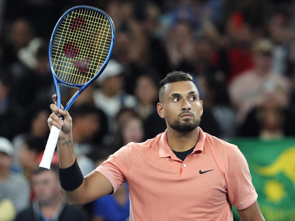 Australia's Nick Kyrgios waves after defeating Italy's Lorenzo Sonego in their first round singles match at the Australian Open tennis championship in Melbourne, Australia, Tuesday, Jan. 21, 2020. (AP Photo/Andy Brownbill)