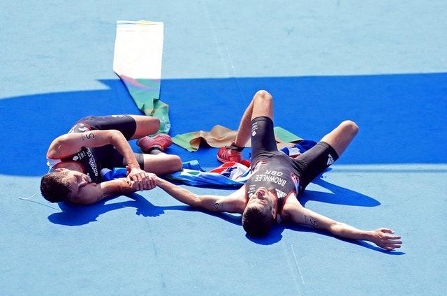 Great Britain's Alistair Brownlee, left, and brother Jonny embrace after winning gold and silver respectively in the men's triathlon at the Rio de Janeiro Olympics in 2016. In sweltering conditions at Fort Copacabana, Alistair pulled away from his younger sibling about halfway through the 10k run to retain his Olympic title by six seconds