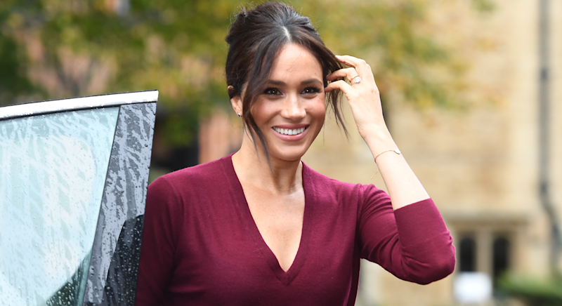 Meghan wore a striking red outfit for the roundtable discussion at Windsor Castle. [Photo: PA]