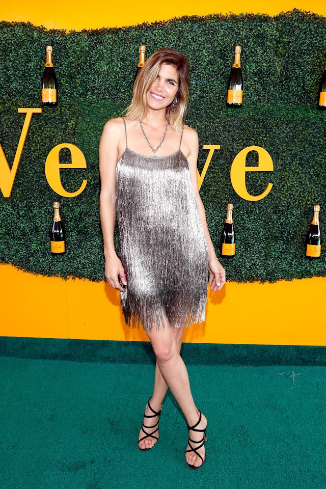 "<p><p>Polo superstar Nacho Figueras's wife Deflina Blaquier was champagne personified in <a rel=""nofollow"" href=""https://rachelzoe.com/shop/ready-to-wear/dresses/della-metallic-fringed-mini-dress/?attribute_pa_color=mecop"">this shimmering Rachel Zoe mini</a>.</p>                                                                                                                                                                               <h4>Getty Images</h4>"