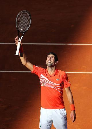 Tennis - ATP 1000 - Madrid Open - The Caja Magica, Madrid, Spain - May 11, 2019 Serbia's Novak Djokovic celebrates winning his semi final match against Austria's Dominic Thiem REUTERS/Sergio Perez