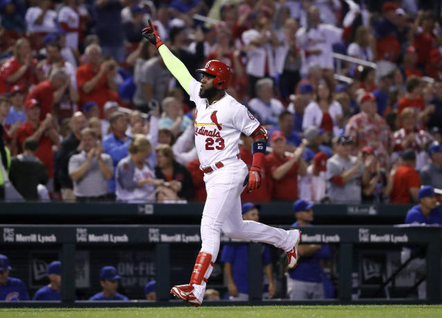 St. Louis Cardinals' Marcell Ozuna celebrates after hitting a two-run home run during the first inning of a baseball game against the Chicago Cubs Sunday, July 29, 2018, in St. Louis. (AP Photo/Jeff Roberson)