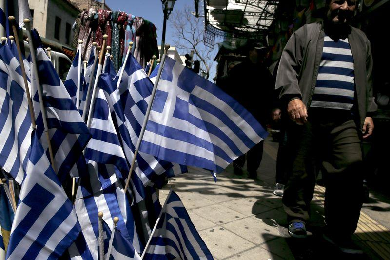 Greek national flags are on display at a shop in central Athens