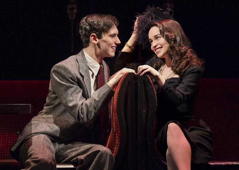 """This theater image released by The O+M Company shows Cory Michael Smith, left, and Emilia Clarke in a scene from """"Breakfast at Tiffany's,"""" performing at the Cort Theatre in New York. (AP Photo/The O+M Company, Nathan Johnson Photography)"""