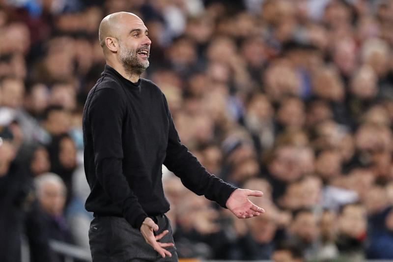 (l-r) coach Pep Guardiola of Manchester City during the UEFA Champions League round of 16 first leg match between Real Madrid and Manchester City FC at the Santiago Bernabeu stadium on February 26, 2020 in Madrid, Spain(Photo by ANP Sport via Getty Images)
