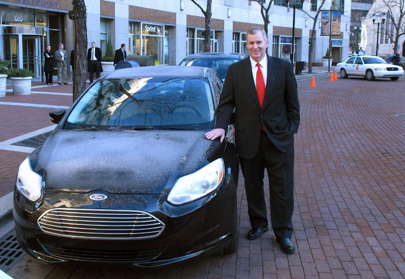 Indianapolis Mayor Greg Ballard talks poses with electric and plug-in hybrid vehicles like these shown following an announcement that the city will replace it's fleet of cars with similar type vehicles in Indianapolis, Wednesday, Dec. 12, 2012. Indianapolis plans to replace its entire fleet with electric and plug-in hybrid vehicles by 2025.  (AP Photo/Rick Callahan)
