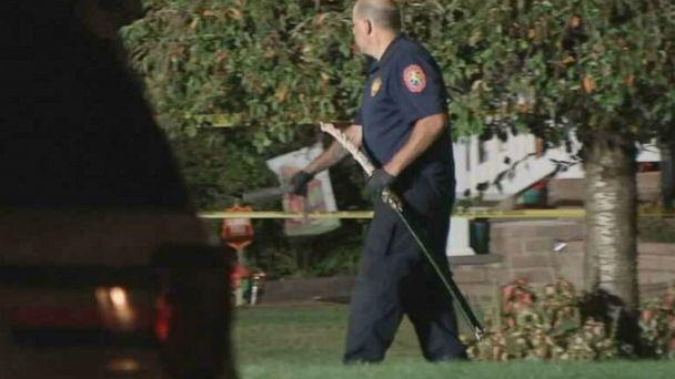 PHOTO: A police officer removes a samurai sword from a Long Island, New York, home after police fatally shot a man who confronted them with the weapon Friday. (WABC)