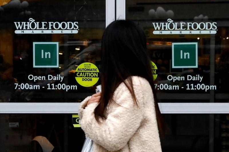 A customer exits a Whole Foods Market in New York