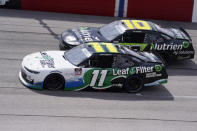 Justin Haley (11) and Ross Chastain (10) vie for position during a NASCAR Xfinity Series auto race Saturday, Sept. 5, 2020, in Darlington, S.C. (AP Photo/Chris Carlson)