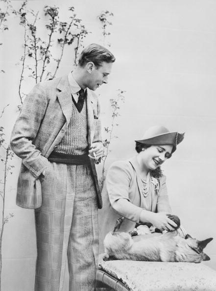 <p>King George VI and the Queen Mother spending some quality time with their four-legged family member.</p>