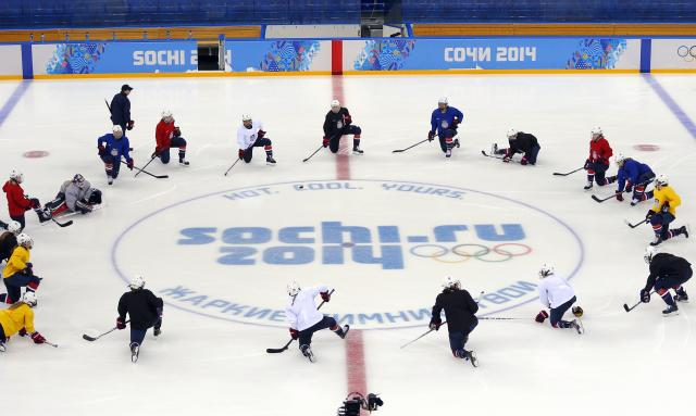 Members of the team USA women's ice hockey team attend a practice session in the Shayba Arena ahead of the 2014 Sochi Winter Olympics February 7, 2014. The women's ice hockey competition begins on February 8. REUTERS/Laszlo Balogh (RUSSIA - Tags: SPORT OLYMPICS ICE HOCKEY)