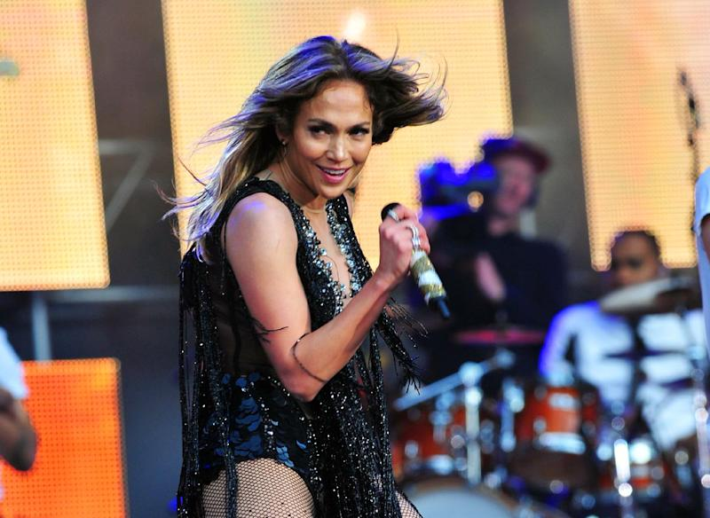 FILE - This June 1, 2013 file photo shows Jennifer Lopez performing at The Sound of Change Live at Twickenham Stadium in London. Lopez will perform a tribute to the late salsa singer Celia Cruz at the American Music Awards on Sunday, Nov. 24. (Photo by Jon Furniss/Invision/AP, File)