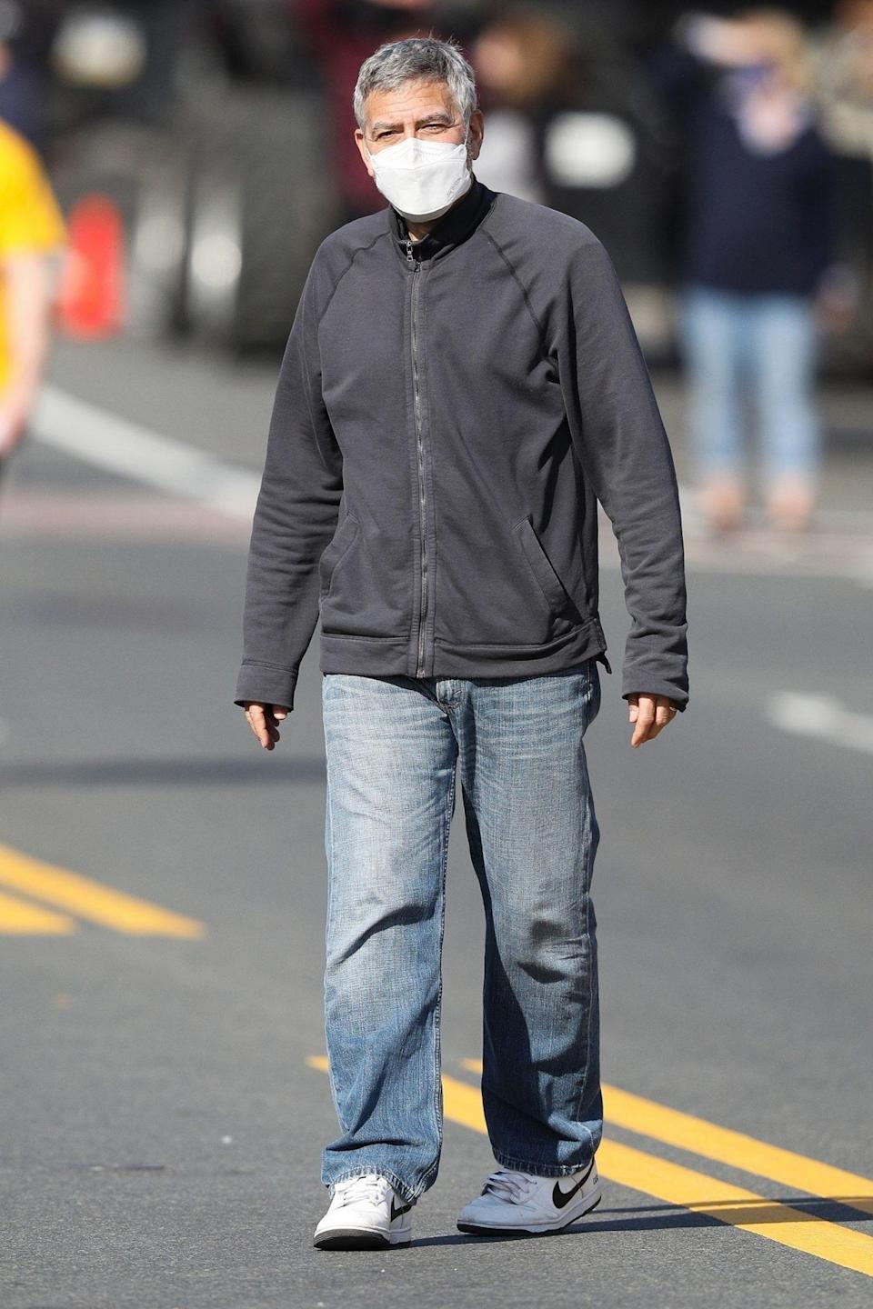 <p>George Clooney is spotted between takes directing <i>The Tender Bar</i> on Thursday in Beverly, Massachusetts. </p>