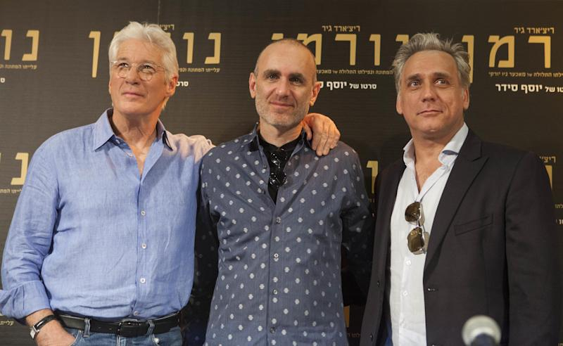 "American actor Richard Gere, left, movie director Joseph Cedar, center, and Israeli actor Lior Ashkenazi, stand for a photo before a press at then premiere of the ""Norman: The Moderate Rise and Tragic Fall of a New York Fixer"" movie in Jerusalem, Thursday, March 9, 2017. (AP Photo/Dan Balilty)"