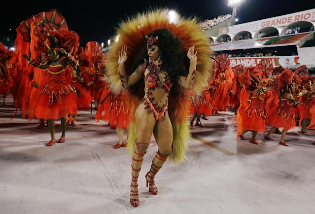 <p>Revellers from Unidos da Tijuca Samba school perform during the second night of the Carnival parade at the Sambadrome in Rio de Janeiro, Brazil, Feb. 12, 2018. (Photo: Pilar Olivares/Reuters) </p>