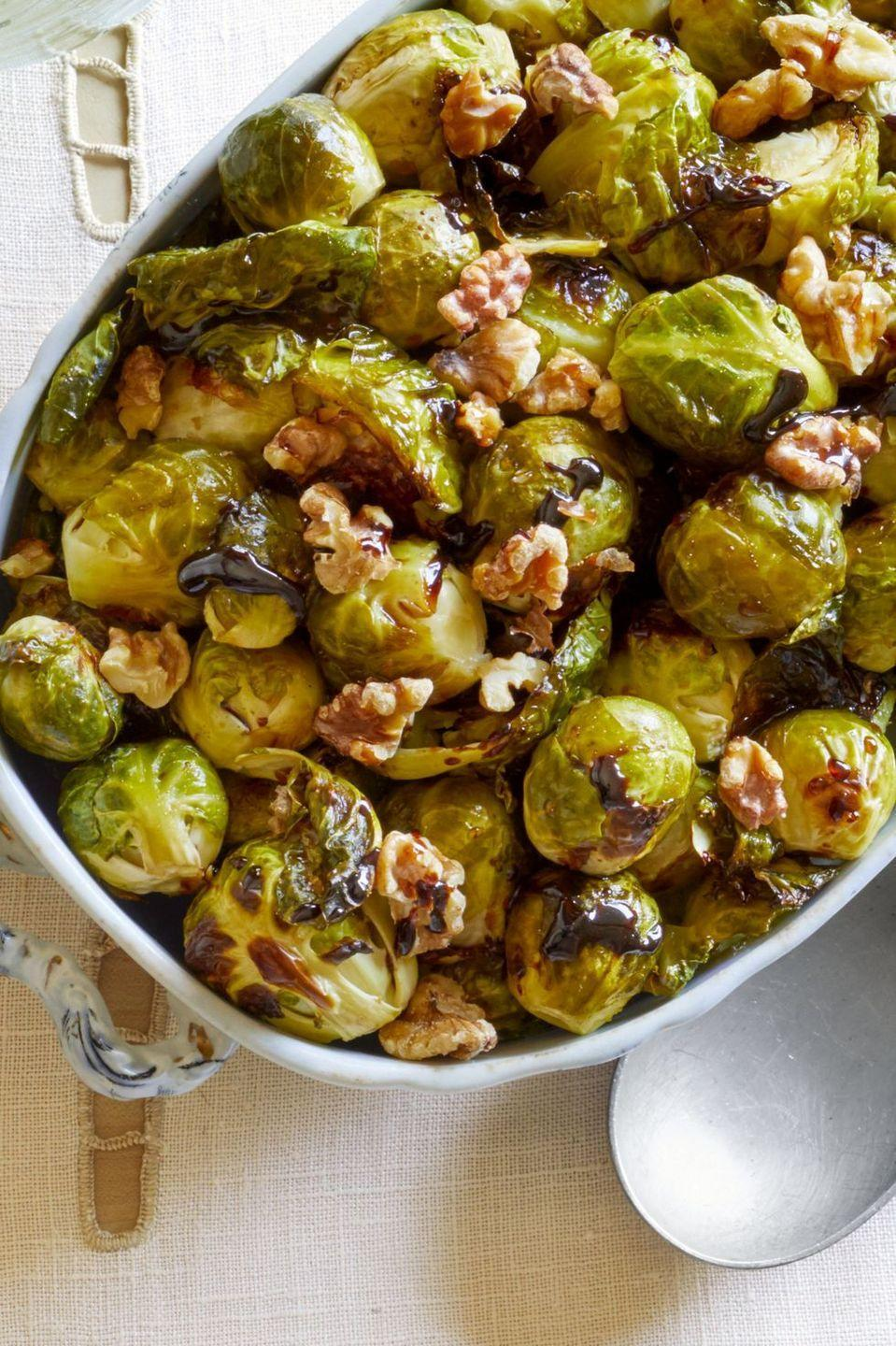 """<p>Wondering how to turn an ordinary veggie dish into a holiday-ready side? Dress it up! Here, Brussels sprouts are joined by a tangy balsamic reduction and crunchy walnuts. </p><p><strong><a href=""""https://www.thepioneerwoman.com/food-cooking/recipes/a33249425/brussels-sprouts-with-balsamic-reduction-walnuts-recipe/"""" rel=""""nofollow noopener"""" target=""""_blank"""" data-ylk=""""slk:Get the recipe"""" class=""""link rapid-noclick-resp"""">Get the recipe</a>.</strong></p><p><a class=""""link rapid-noclick-resp"""" href=""""https://go.redirectingat.com?id=74968X1596630&url=https%3A%2F%2Fwww.walmart.com%2Fsearch%2F%3Fquery%3Dcookware&sref=https%3A%2F%2Fwww.thepioneerwoman.com%2Ffood-cooking%2Fmeals-menus%2Fg35589850%2Fmothers-day-dinner-ideas%2F"""" rel=""""nofollow noopener"""" target=""""_blank"""" data-ylk=""""slk:SHOP COOKWARE"""">SHOP COOKWARE</a></p>"""