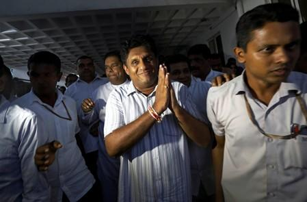 Sri Lanka's housing minister and deputy leader of the ruling United National Party Premadasa meets with his party members at the party office after he was nominated as a presidential candidate in Colombo