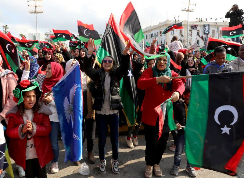 Libyans celebrate the 9th anniversary of the revolution at Martyrs' Square in Tripoli