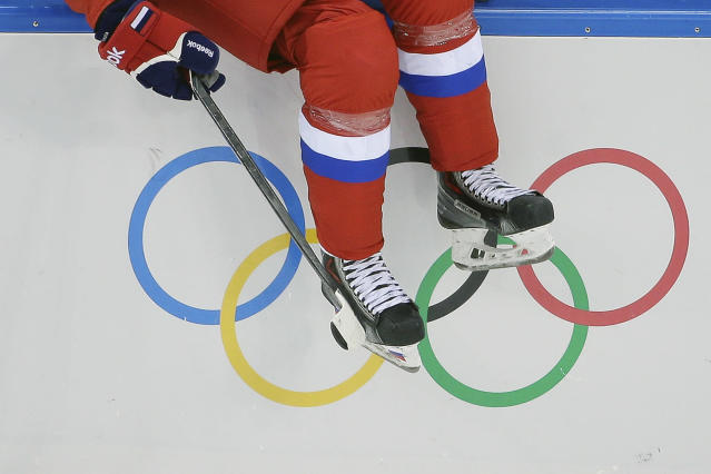 Svetlana Tkachyova of Russia sits on the boards waiting to the enter the game against Germany during the first period of the 2014 Winter Olympics women's ice hockey game at Shayba Arena, Sunday, Feb. 9, 2014, in Sochi, Russia. (AP Photo/Matt Slocum)