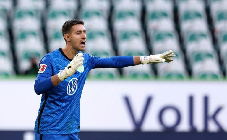 Wolfsburg's Belgium goalkeeper Koen Casteels pulled off a dramatic late penalty save to seal Sunday's 2-1 win over Hoffenheim