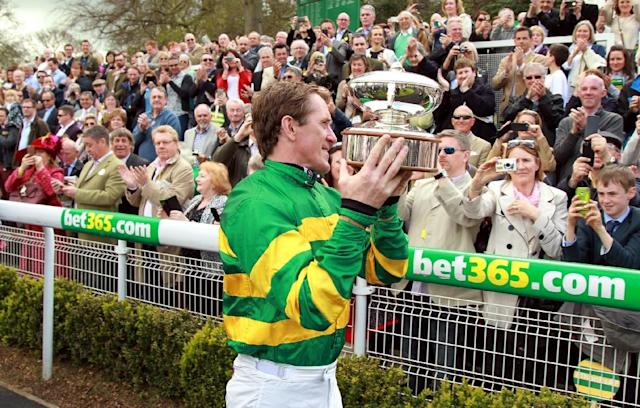 20-times champion jumps jockey AP McCoy broke nearly every bone in his body but he wouldn't have swapped his career for anything (AFP Photo/SEAN DEMPSEY)