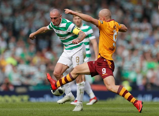Soccer Football - Scottish Cup Final - Celtic vs Motherwell - Hampden Park, Glasgow, Britain - May 19, 2018 Celtic's Scott Brown in action with Motherwell's Curtis Main REUTERS/Russell Cheyne
