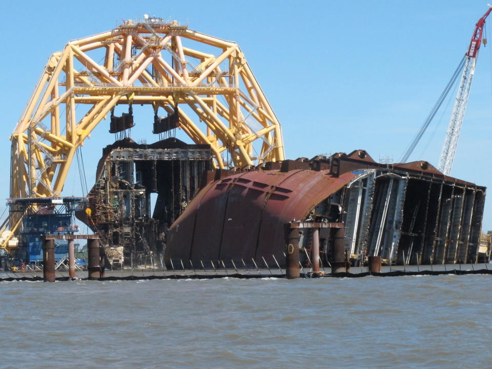 FILE - In this April 26, 2021 file photo, a towering crane pulls the engine room section away from the remains of the capsized cargo ship Golden Ray offshore of St. Simons Island, Ga. Accounts contained in crew member interviews are among more than 1,700 pages of documents made public Thursday, July 29, by the National Transportation Safety Board. The Golden Ray, carrying more than 1,400 vehicles, overturned after leaving the Port of Brunswick along the Georgia coast on Sept. 8, 2019. Tennant and about two dozen crew members on board were rescued and survived. (AP Photo/Russ Bynum, File)