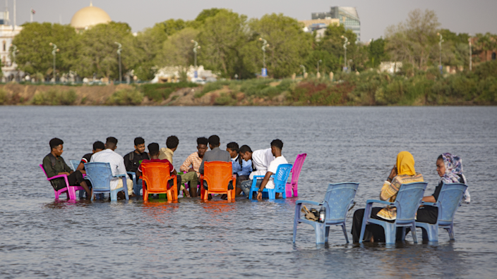 People sitting on chairs in the River Nile in Khartoum, Sudan - Tuesday 25 May 2021