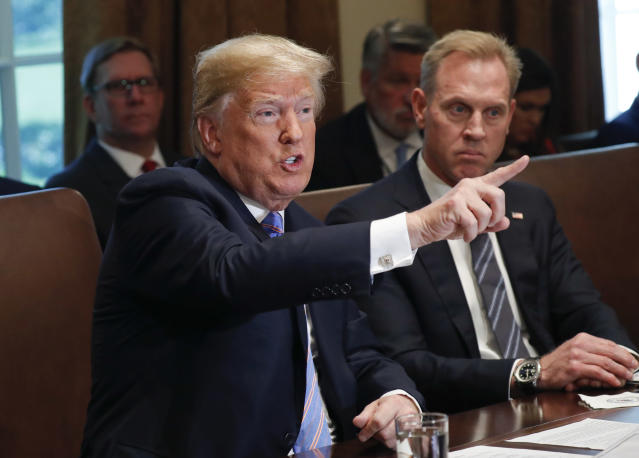President Trump gestures during a meeting at the White House on Wednesday with members of his Cabinet. Looking on is Deputy Secretary of Defense Patrick Shanahan. (Photo: Pablo Martinez Monsivais/AP)