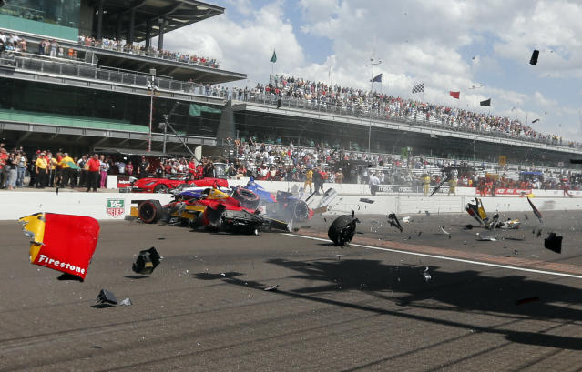 Sebastian Saavedra, left, of Colombia, is hit by Mikhail Aleshin, of Russia, at the start of the inaugural Grand Prix of Indianapolis IndyCar auto race at the Indianapolis Motor Speedway in Indianapolis, Saturday, May 10, 2014. (AP Photo/Robert Baker)