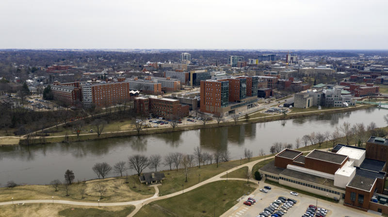 The college town of Iowas City is pictured here behind the Iowa River