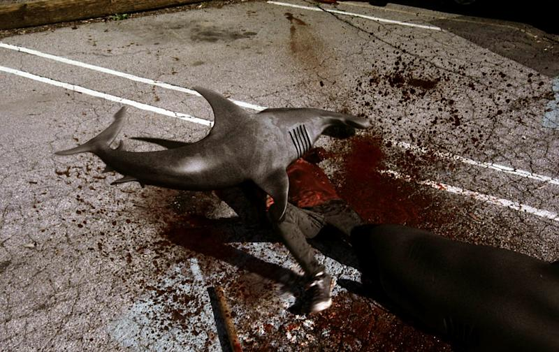 "In this image released by Syfy, sharks attack a man in a scene from the Syfy original film ""Sharknado."" The network is announcing a sequel to ""Sharknado,"" which became an instant campy classic with its recent airing. The new film premieres in 2014. (AP Photo/Syfy)"