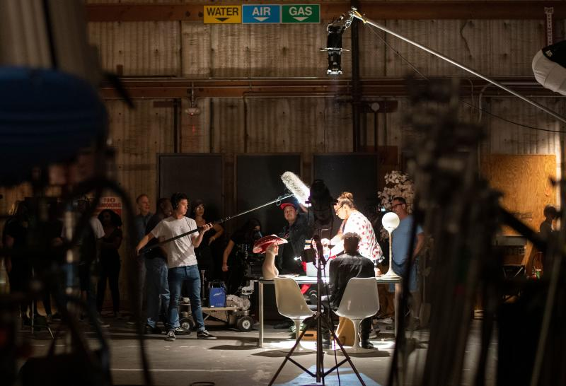 """Interns shoot a scene during a session of the Academy Gold Production Track Program at Warner Bros Ranch in Burbank, California, on August 1, 2019. - The """"Academy Gold"""" summer program sees aspiring filmmakers attend panels and workshops across Los Angeles in collaboration with Tinseltown giants including Disney, Sony and Paramount. It was set up in the aftermath of the #OscarsSoWhite campaign which criticized the industry's lack of diversity. (Photo by VALERIE MACON / AFP) (Photo credit should read VALERIE MACON/AFP via Getty Images)"""