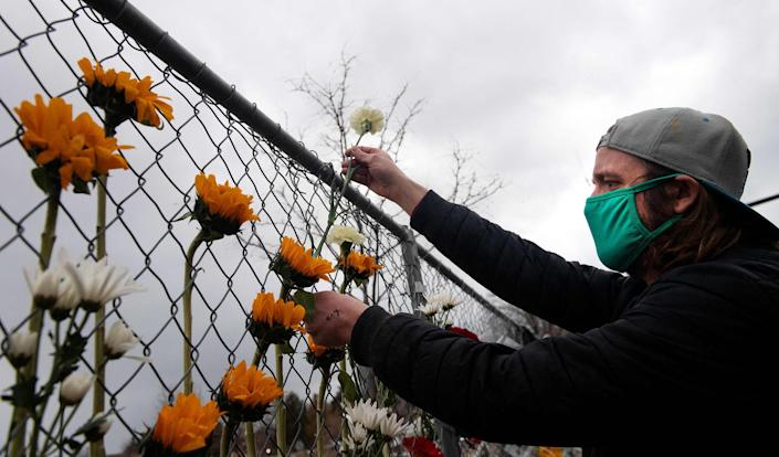 Image: A makeshift memorial in Boulder, Colo. (Jason Connolly / AFP - Getty Images)