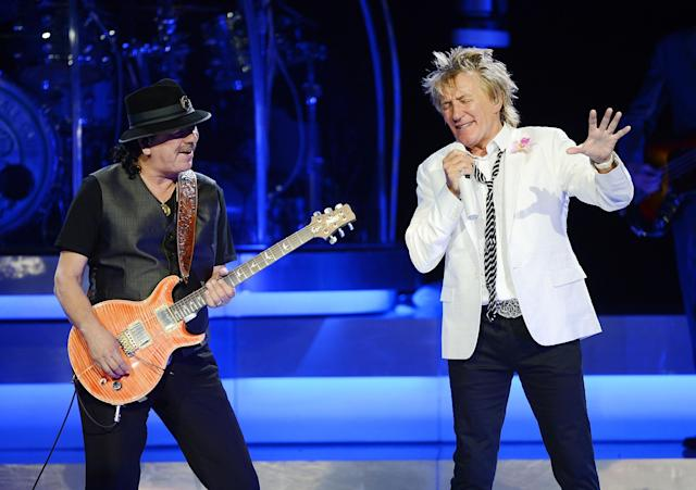 LAS VEGAS, NV - MAY 06: Carlos Santana and Rod Stewart perform together ahead of their US co-headlining tour launching May 23. Seen here during Rod Stewarts show at Caesars Palace on May 6, 2014 in Las Vegas, Nevada. (Photo by Denise Truscello/Getty Images for Caesars Ent)