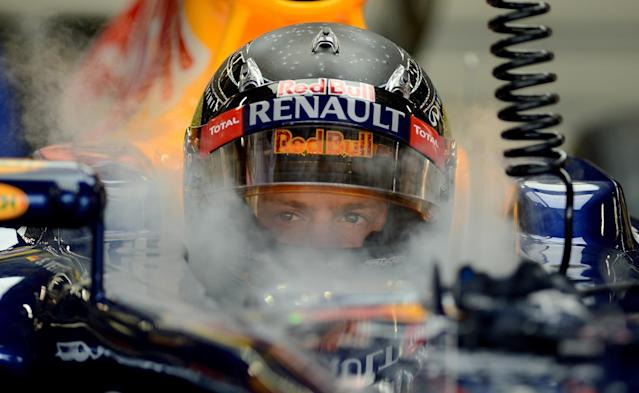 -- AFP PICTURES OF THE YEAR 2012 -- Red Bull Renault driver Sebastian Vettel of Germany sits in his Formula One race car during the first practice session of Formula One's Singapore Grand Prix in Singapore on September 21, 2012. AFP PHOTO / Punit PARANJPEPUNIT PARANJPE/AFP/Getty Images