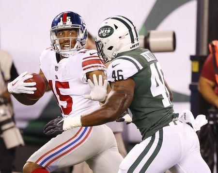 Aug 24, 2018; East Rutherford, NJ, USA; New York Giants wide receiver Hunter Sharp (15) stiff arms New York Jets linebacker Neville Hewitt (46) before scoring a touchdown on a punt return during first half at MetLife Stadium. Mandatory Credit: Noah K. Murray-USA TODAY Sports