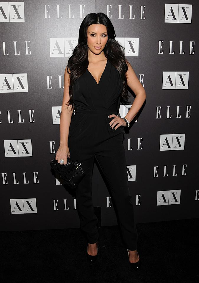 "Reality hottie Kim Kardashian and other celebs danced down the red carpet at <i>Elle</i> and A/X Armani Exchange's Disco Glam party at the label's West Hollywood store. Mark Sullivan/<a href=""http://www.wireimage.com"" target=""new"">WireImage.com</a> - May 25, 2010"
