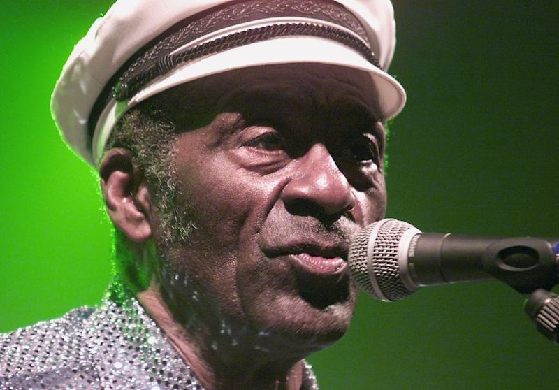 "Chuck Berry, pictured in 2003, won cheering crowds with his consummate showmanship, including his ""duck walk"" across stage, and lyrics that celebrated youthful freedom"