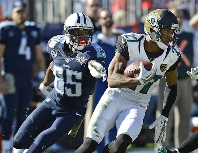 Jacksonville Jaguars cornerback Dwayne Gratz (27) runs the ball back after intercepting a pass intended for Tennessee Titans wide receiver Nate Washington (85) in the second quarter of an NFL football game on Sunday, Nov. 10, 2013, in Nashville, Tenn. (AP Photo/Mark Zaleski)