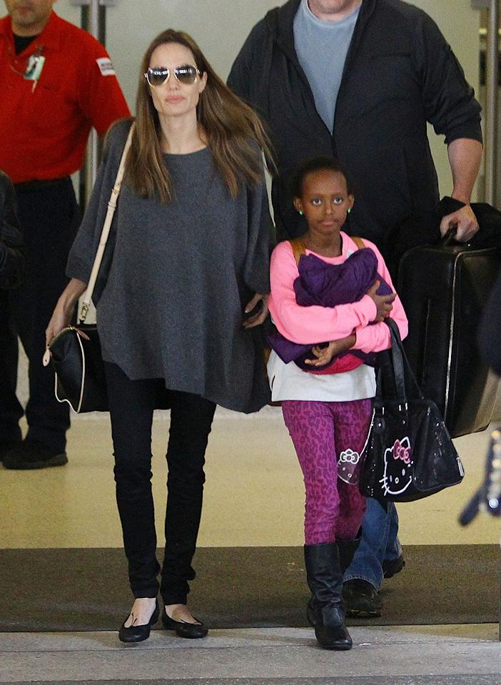 "<div class=""caption-credit"">Photo by: Courtesy of Splash News</div><div class=""caption-title""></div>With six kids, one rarely sees Angelina Jolie without her brood. Hands-on no matter what part of the globe she's in, here, Jolie with daughter Zahara, look ready to take on anything. <p>  <br>  <b>See more:  <br>  <a rel=""nofollow"" href=""http://www.vogue.com/fashion/most-wanted/most-wanted-mothers-day-may-10/?mbid=synd_yshine"" target="""">10 Extravagant, Sentimental Mother's Day Gifts</a>  <br>  <a rel=""nofollow"" href=""http://www.vogue.com/fashion/most-wanted/most-wanted-august-16-beauty-for-every-age/?mbid=synd_yshine"" target="""">Best Beauty Looks for All Ages</a></b><b><a rel=""nofollow"" href=""http://www.vogue.com/fashion/most-wanted/most-wanted-august-16-beauty-for-every-age/?mbid=synd_yshine"" target=""""><br></a></b> </p>"